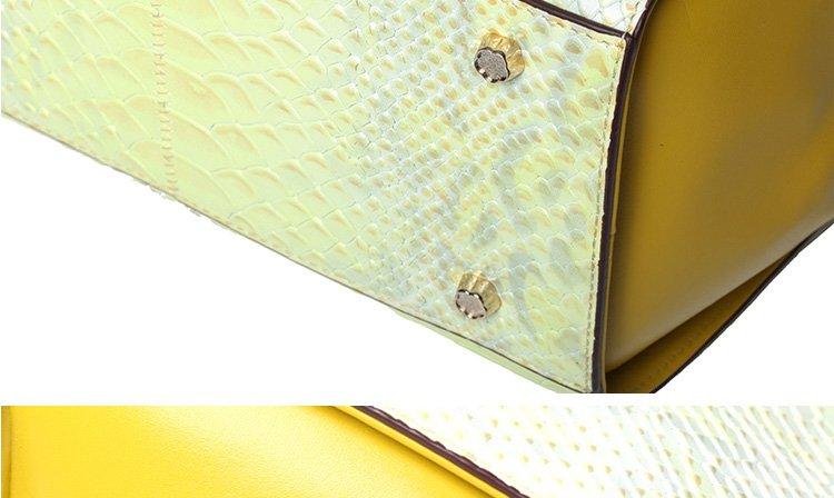 商品名称: 经典蟒蛇纹手提包柠黄 商品分类: 手提包 产地: 中国广州